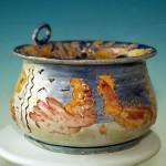 scultura in ceramica mostra comoditas